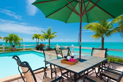 Dine alfresco by your own private pool and the turquoise ocean