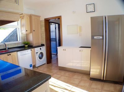 Fully equipped kitchen with American style fridge freezer