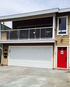 View of the front of the property. Red door is upstairs listing #63877.