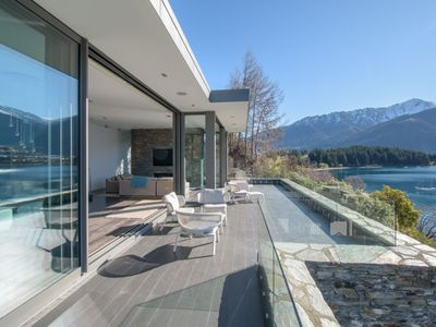 Photo for Lakeside Luxury - stunning waterfront location with all-day sun and spa pool