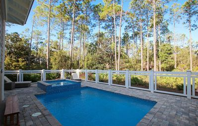 In-ground pool with out door spa and loungers with wooded privacy