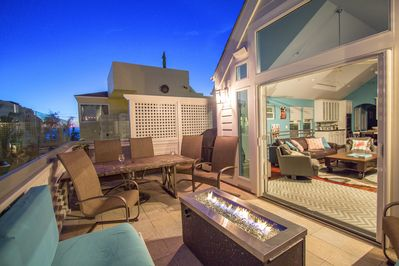 Second floor beautiful glass balcony w/ ocean views, fit pit, seating & BBQ