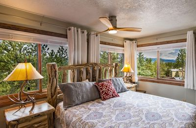 Grand master bedroom with rustic furnishings and a king bed