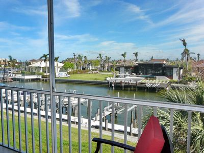 Photo for Tranquil waterfront condo w/ heated pools & short walk from South Beach