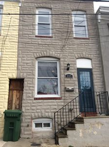 This cute Baltimore rowhome is over a century old.