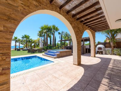 Photo for A wonderful beach front villa with mature gardens & luxurious living throughout