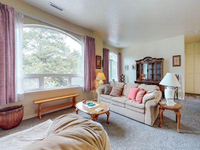 Photo for NEW LISTING! Upstairs apartment with river views, shared hot tub & beach nearby!