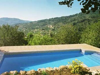Photo for Stone house with pool surrounded by orange and olive groves