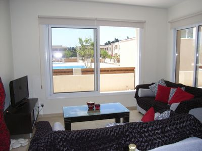 Photo for Stunning ground floor apartment with poolside view-Walking distance to the beach