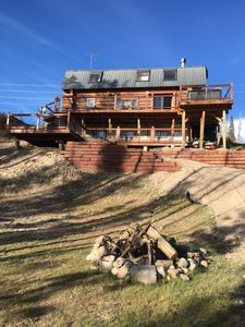 Photo for Rustic Elegance, hot tub under the stars, mtn views and only 3 miles to town