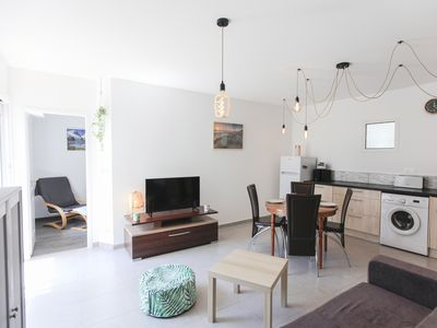 Photo for 300 meters from the beach, bright apartment with private parking!