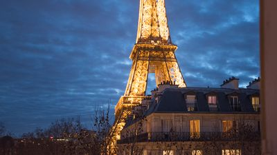 Watch the Eiffel Tower light up and sparkle after dark right from your window