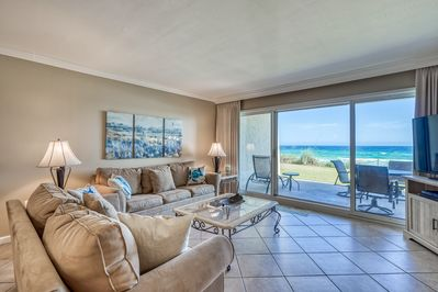 Living room opens up to patio w/ Gulf views!