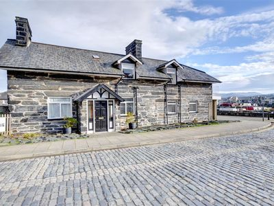 Photo for This beautifully presented cottage has been created on the ground floor of the old wharf masters hou