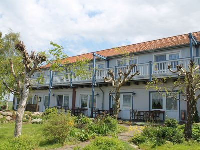 Photo for 2 apartments with beautifully landscaped garden near the beach