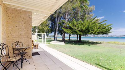 Photo for Sandy Beach House Corlette, 1/146 Sandy Point Road - Waterfront, WIFI, Aircon & Foxtel