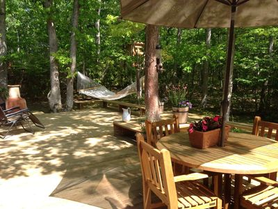 Deck overlooks private wooded 1-acre