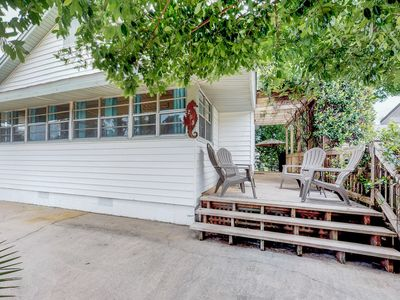 Photo for Cozy, dog-friendly cottage w/ large porch & private yard - 1 block to beach!