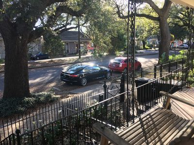 Watch the world go by along the live-oak lined Avenue