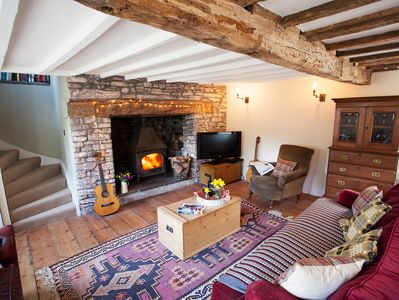 Lounge with wood burner and exposed beams