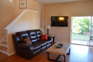 """Family Room - Couch with recliners and 50"""" TV"""