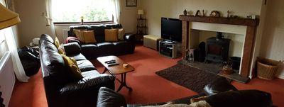 Main lounge with multi-fuel stove, entertainment and plenty of space