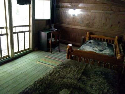 Two single beds and desk in the Rustic Retreat Cabin