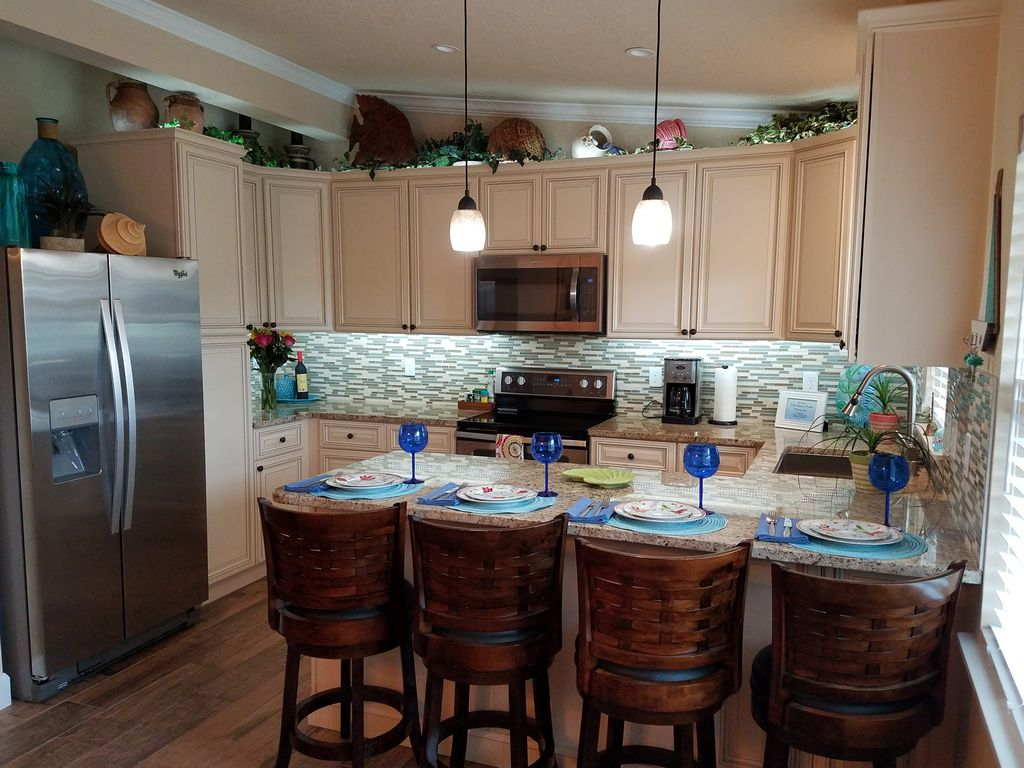 Fully Stocked Granite Kitchen And Breakfast Bar.