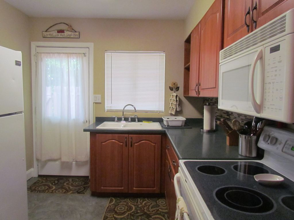 Kitchen With Full Stove And Oven, Microwave, Refrigerator.