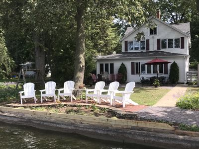 View from pier of private swim area and newly landscaped sitting area; gas grill