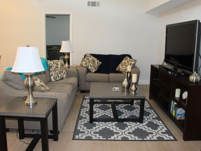 Photo for Walk to DOWNTOWN PS, watch sunsets from the patio, recreation, heated pool, jac.