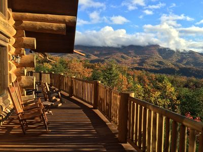 Magnificent Fall view from the upstairs wrap-around deck with rocking chairs