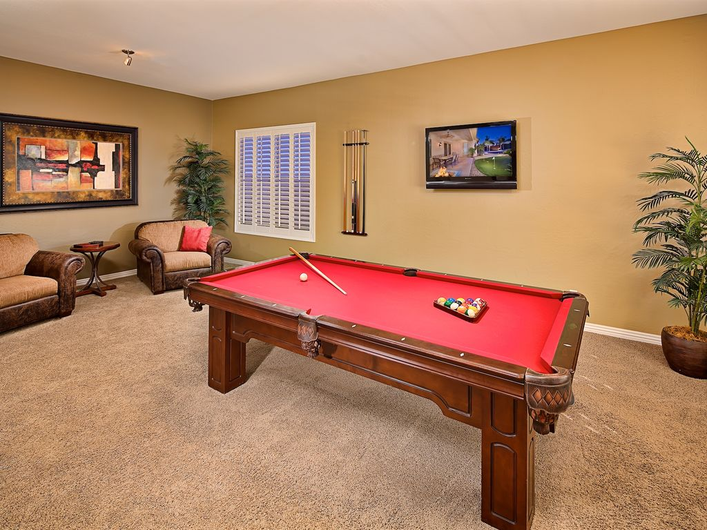 Entertain In The Game Room And Play A Round Of Pool And Watch The Latest  Game