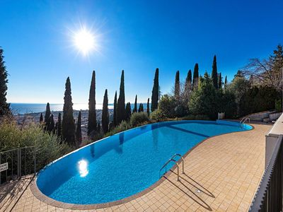 Photo for Beautiful duplex apartment with private garden overlooking the Monte Pizzocollo, infinity pool and a wonderful view of Lake Garda