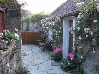 Photo for Tastefully refurbished Cottage c1762 in village 1/2 mile to award winning beach.