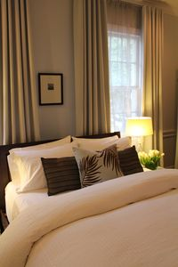 Bedroom features luxury linens and designer styling