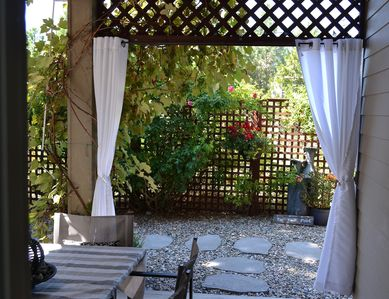 Private patio with private terrace leading to pool left and parking right