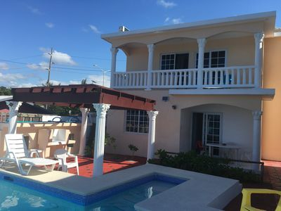 Photo for Apartment by the sea with a small sandy beach, pool and fantastic views