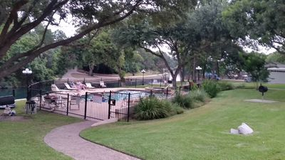 Photo for Riverfront condo on the Comal 3 min from Schlitterbahn Sleeps 4 adults & 2 chil