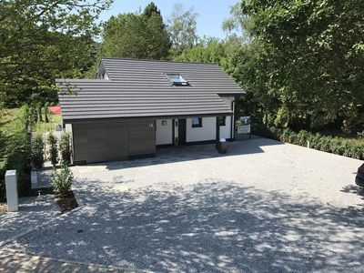 """Photo for Detached holiday home at the Edersee Rehbach """"Das Haus am See"""" 4 Stars DTV,"""