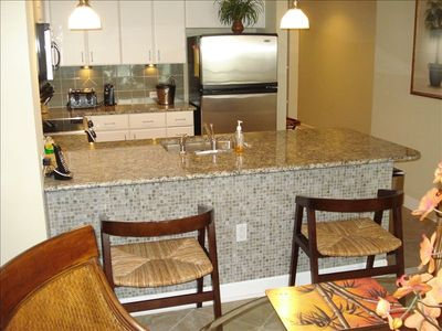 All the upgrades offered you will enjoy this condo!! Lots of designer tile work!