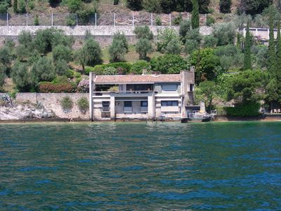 Photo for Lake front villa with private beach and swimming dock, breathtaking lake views