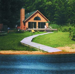 Photo for Bass Lake  Retreat. 300ft of Secluded Waterfront.  Within minutes of downtown.
