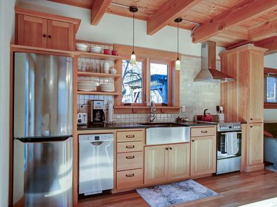 new gourmet kitchen features high end appliances  and granite counters