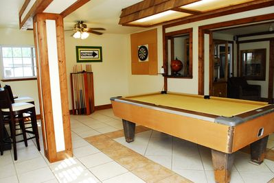 Game room with pool table, dart board