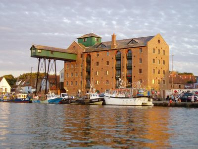 Photo for Situated in an old granary building, this apartment boasts amazing views over the harbour .