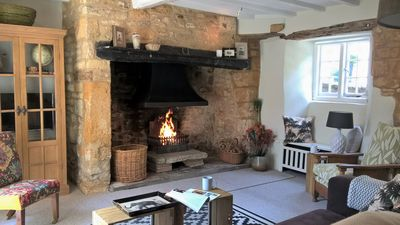 Photo for Spectacular 3 double bedroom Cotswold stone cottage with original Inglenook fire