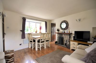 Cosy Lounge with Dining Table and Feature Fire!