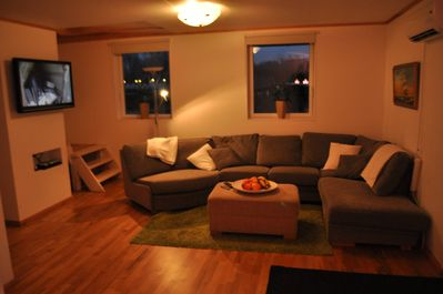 Relaxation house Large, comfortable sofa with TV