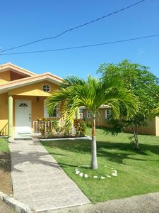 Photo for Home Away from home in a gated community, 15 mins drive to Ochi Rios , WIFI avai